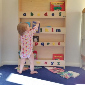 baby with Tidybooks bookcase
