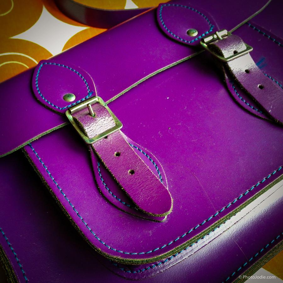 purple leather satchel