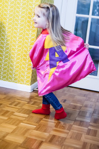 Little girl wearing a Superhero capes from Jem Sewing alterations