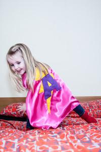 Girl wearing super hero cape