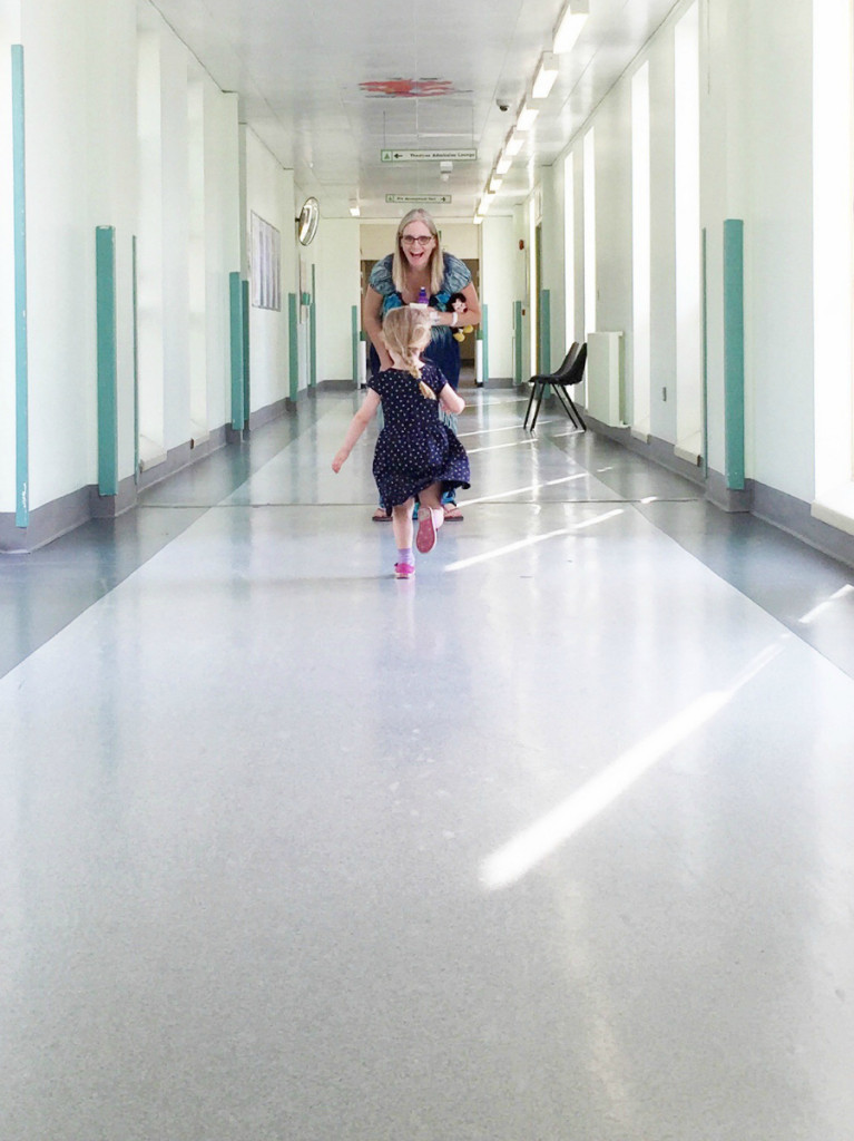 little girl running to meet her mum in hospital