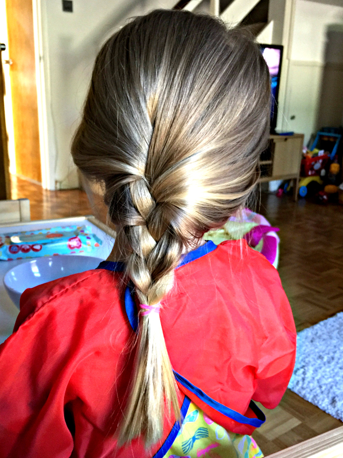 little girl with hair platted