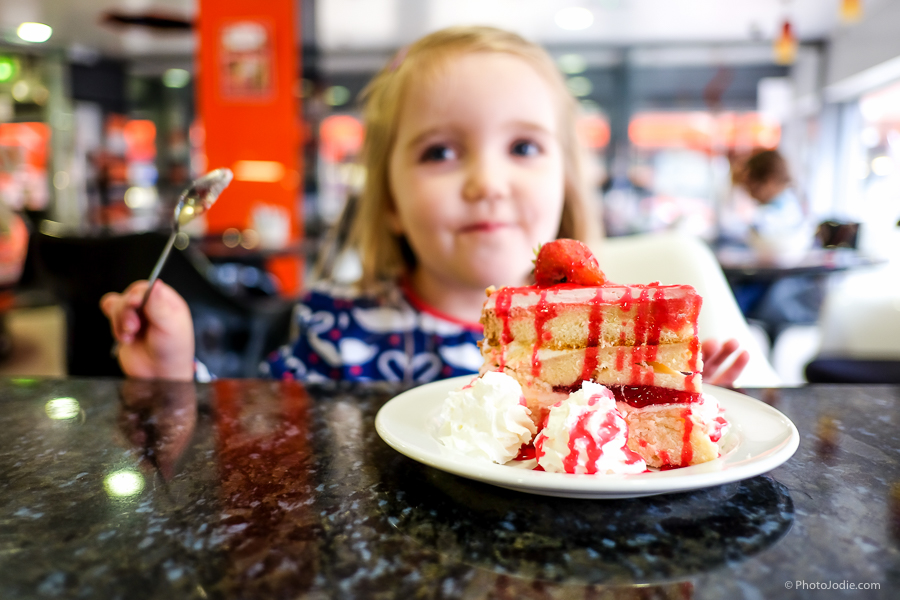 girl eating cake at liens delight cafe bar in maidenhead