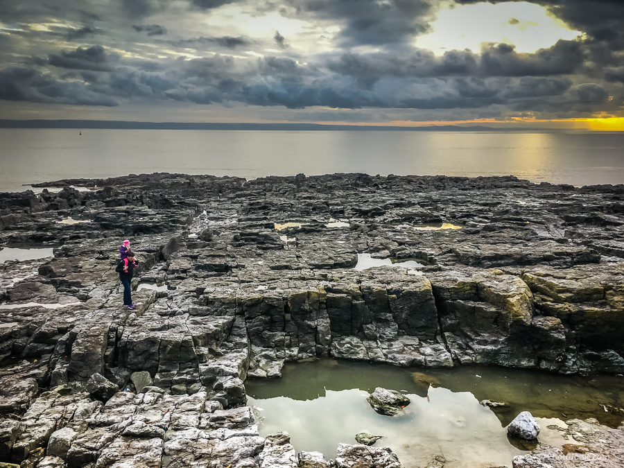 Exploring the rock pools at Porthcawl beachfront