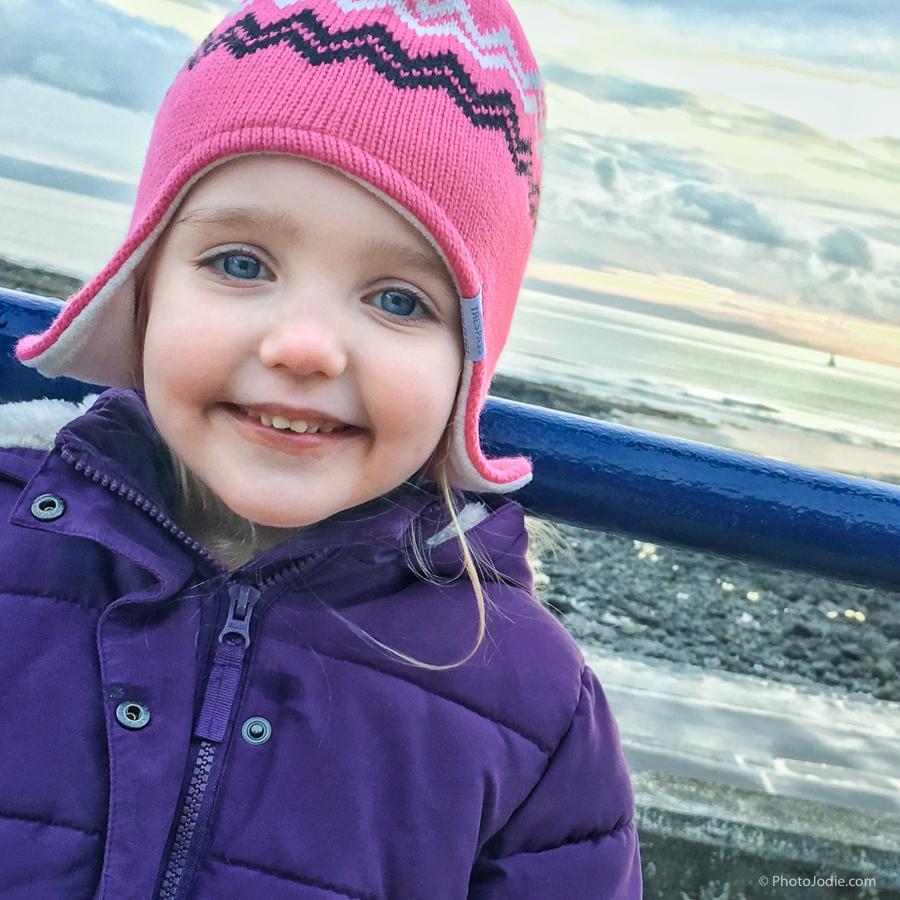 Girl at winter seaside Porthcawl