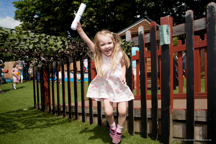 Jumping for joy at the thought of going to her new school.