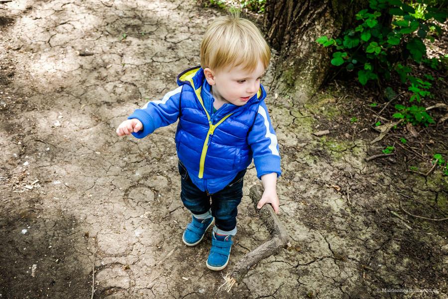 Child in woods at Bisham woods Maidenhead
