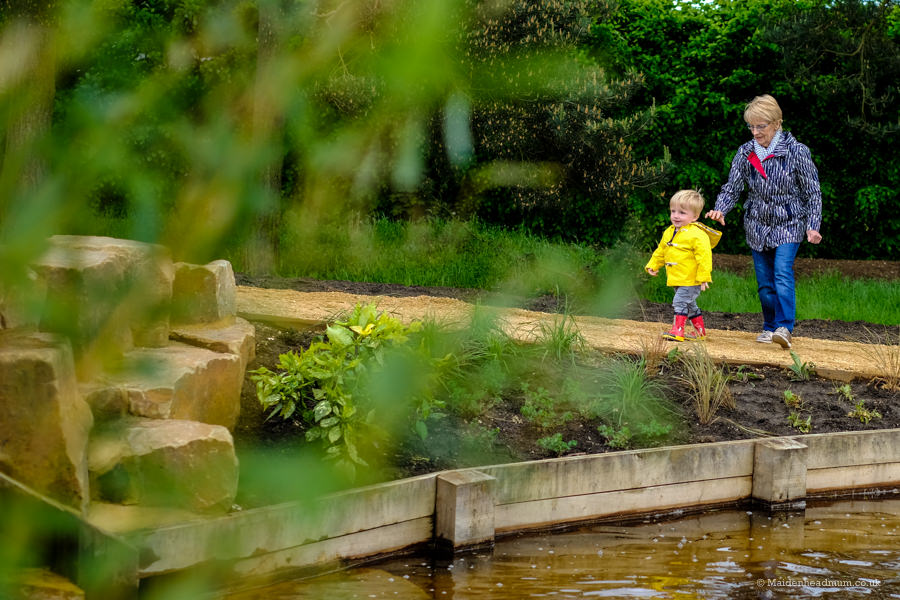 Child exploring Nicholas Winton Memorial garden in Maidenhead Oaken Grove Park