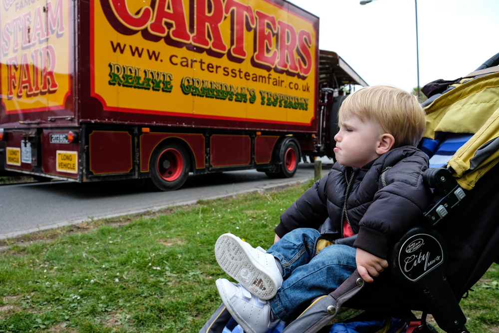 Little boy next to a big truck at carters steam fair road run
