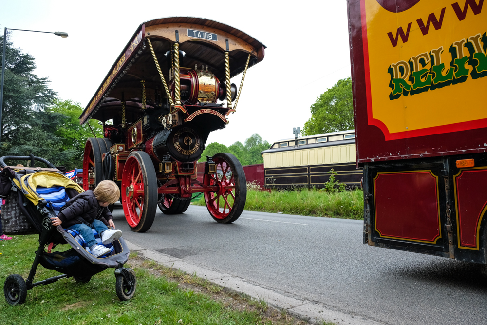 little boy watched the carters steam fair vintage road run from his buggy