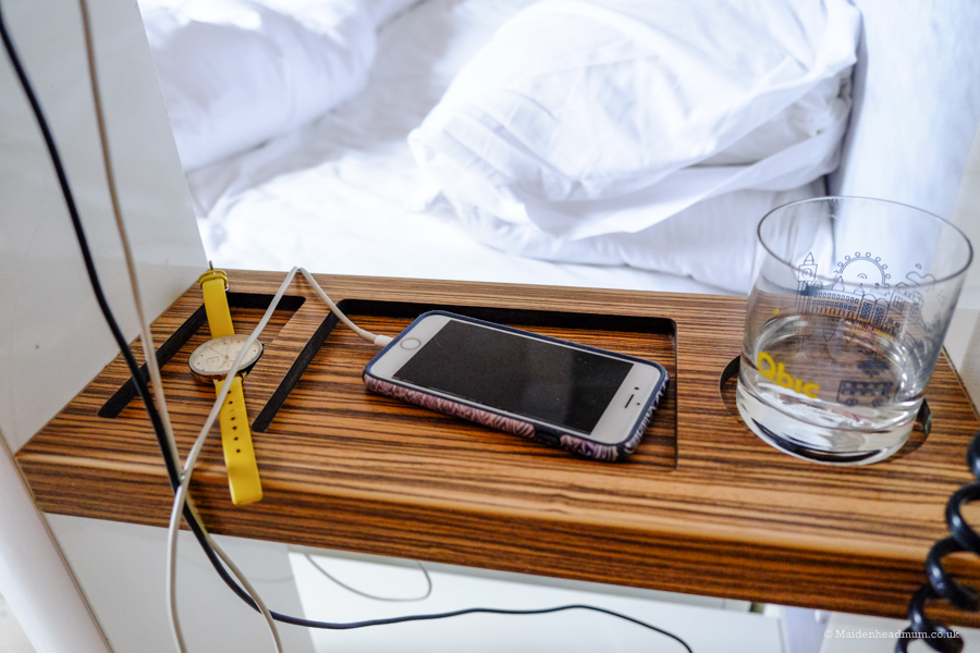 Charging your phone next to your bed at the Qbic Hotel London