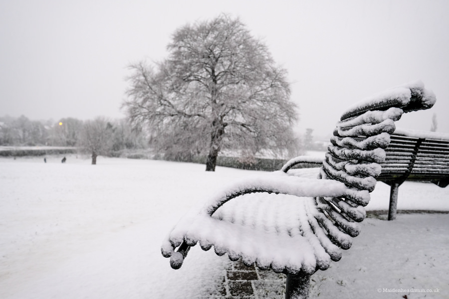 Snow covered bench in Maidenhead
