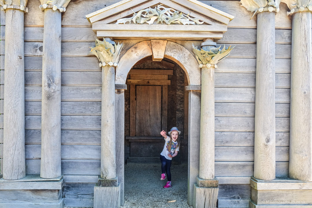 Children enjoy playing in the architecture in the gardens at Arundel Castle