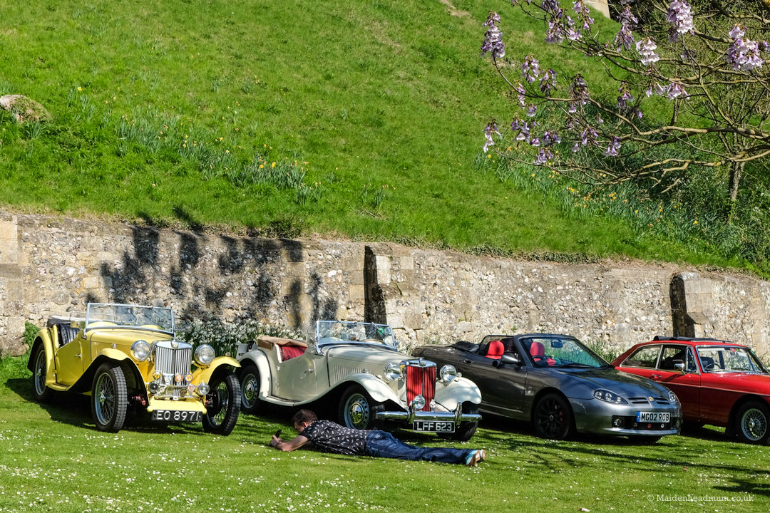 man taking photo of car at arundel castle