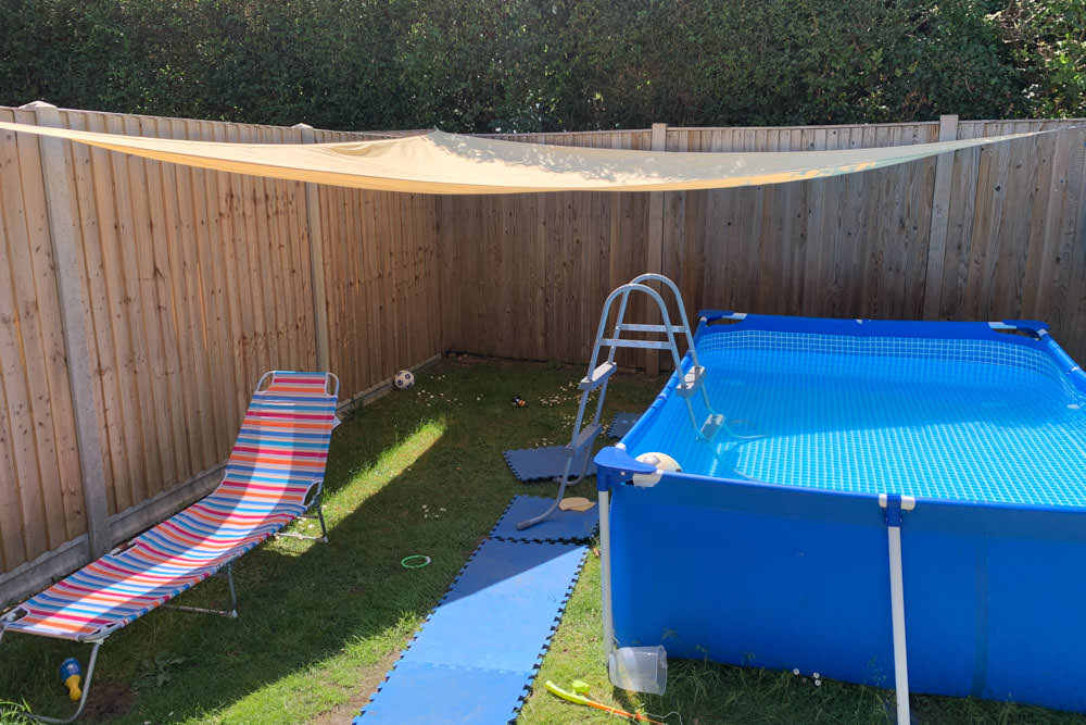 A sun shade can give shade for a large paddling pool