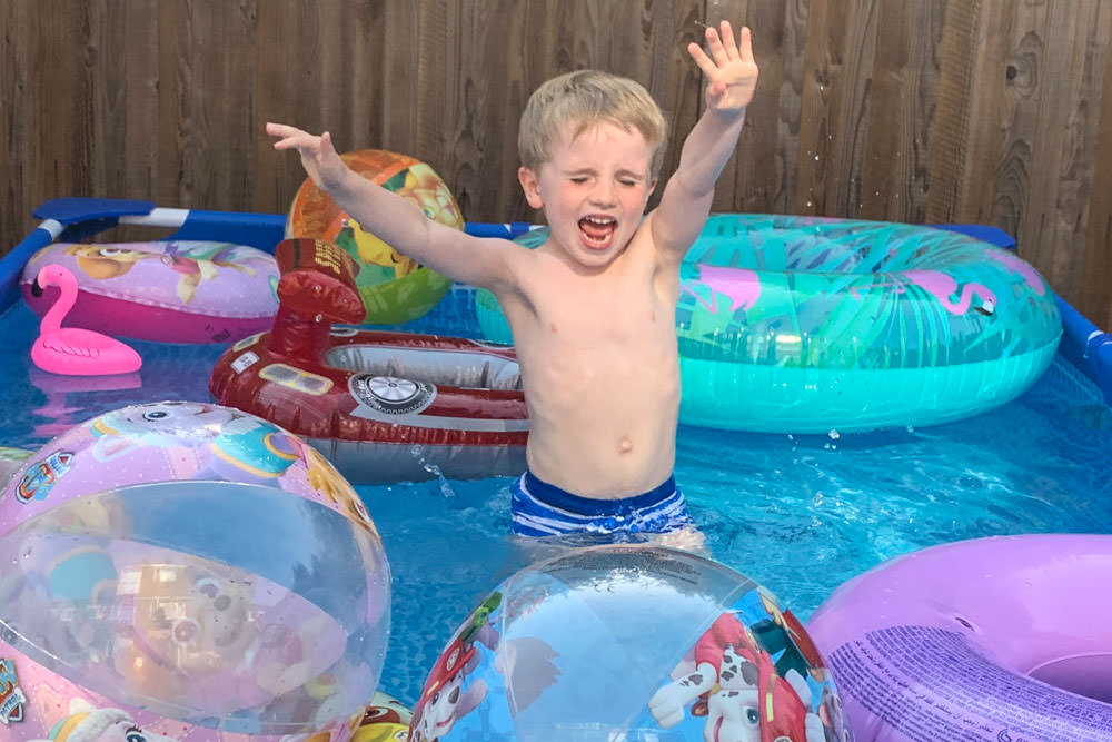 having fun all year round in a large paddling pool