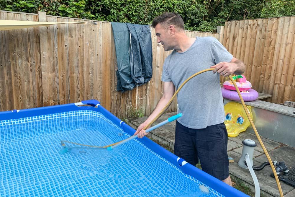 Using a pool hoover to keep the paddling pool clean